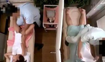 夫婦で訪れたマッサージ店で仕切りで区切った夫の隣で奥さんを寝取っちゃう悪徳整体師のカメラ映像